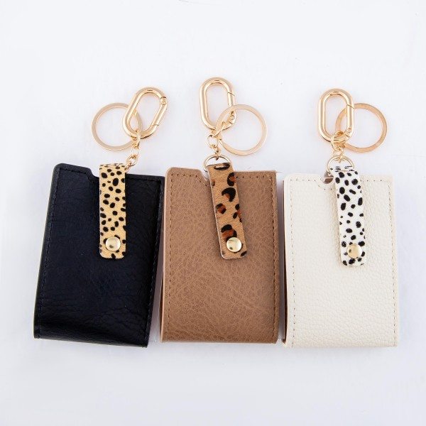 """Genuine Leather Mask Keeper Keychain Holder Featuring Animal Print Detail.  - Keyring to hold your Keys - Detachable Clip for Clipping onto Purse or Bag - Easy to Clean - Quick & Easy Way to Store Your Mask - Lay Mask Flat, Fold Long Ways, Fold in Half and Button - Approximately 3"""" x 2.5"""""""