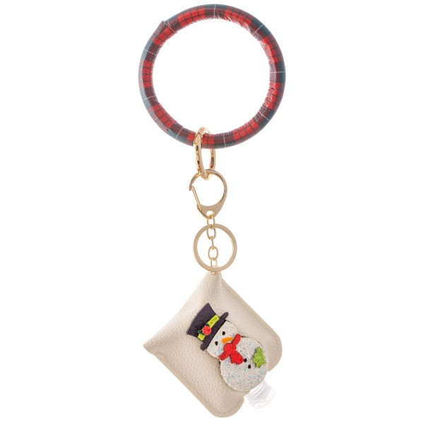 """PU Plaid Print Christmas Key Ring Hand Sanitizer Holder Bangle Wristlet Featuring a Raised Glitter Snowman Design.  - Keyring to hold your keys - Can Be Worn as Wristlet - Detachable - Ring 3""""  - Fits up to 1fl.oz Sanitizer Bottle - Approximately 3"""" T x 2.5"""" W - (Approx) 10"""" L overall  ***Hand Sanitizer NOT INCLUDED. (Comes with empty Bottle)"""