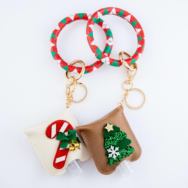 """PU Argyle Diamond Christmas Key Ring Hand Sanitizer Holder Bangle Wristlet Featuring a Raised Glitter Candy Cane Design.  - Keyring to hold your keys - Can Be Worn as Wristlet - Detachable - Ring 3""""  - Fits up to 1fl.oz Sanitizer Bottle - Approximately 3"""" T x 2.5"""" W - (Approx) 10"""" L overall  ***Hand Sanitizer NOT INCLUDED. (Comes with empty Bottle)"""