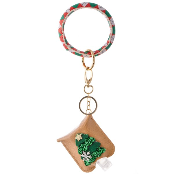 """PU Argyle Diamond Christmas Key Ring Hand Sanitizer Holder Bangle Wristlet Featuring a Raised Glitter Christmas Tree Design.  - Keyring to hold your keys - Can Be Worn as Wristlet - Detachable - Ring 3""""  - Fits up to 1fl.oz Sanitizer Bottle - Approximately 3"""" T x 2.5"""" W - (Approx) 10"""" L overall  ***Hand Sanitizer NOT INCLUDED. (Comes with empty Bottle)"""