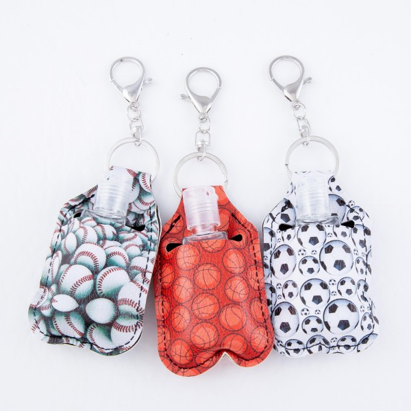 "PU Neoprene baseball Hand Sanitizer Holder/Keychain Holder.  - Can Attach to Keys / Purses / Bags / Backpacks Etc. - Hand Sanitizer Not Included** - Holds 1fl oz  - Outside Material: PU - Inside Material: Neoprene - Approximately 4"" T x 2.5"" W  ** Comes with Empty Sanitizer Bottle."