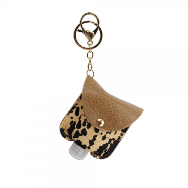 """Genuine Leather Animal Print Hand Sanitizer Holder.  - Clip To Your Purse, Bag, or Diaper Bag - Key Ring to Hold Your Keys - Fits Up to 1 Fl Oz Sanitizer Bottle - Approximately 3"""" T x 2.5"""" W  ***Hand Sanitizer NOT INCLUDED. (Comes with empty Bottle)"""