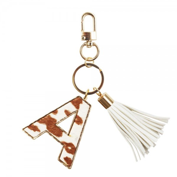 """Genuine Leather Animal Print Keychain Featuring a Tassel Accent.   - Keyring to Hold Your Keys - Clip to Clip Onto Your Bag/Purse or Backpack - Initial Approximately 2"""" - (Approx) 5"""" Overall"""