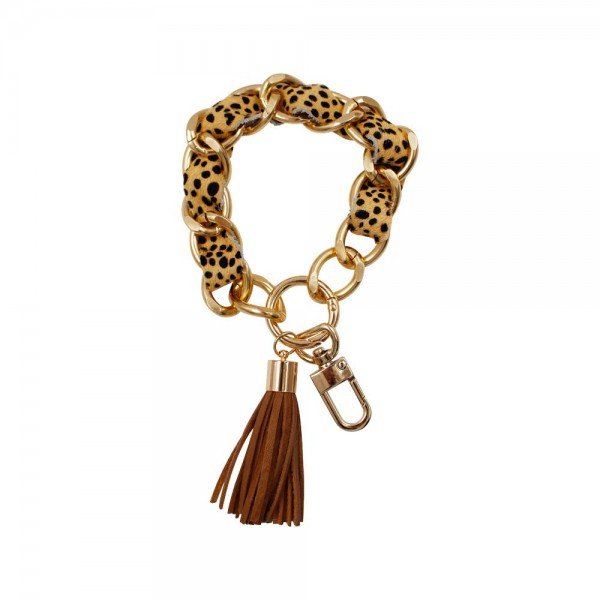 """Animal Print Keychain Featuring Tassel.   - Clip to Purses or Backpacks - Approximately 3"""" in Diameter"""