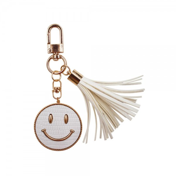 """Smiley Face Keychain Featuring Tassel.   - Clip to Purses or Backpacks - Approximately 1.5"""" in Diameter"""