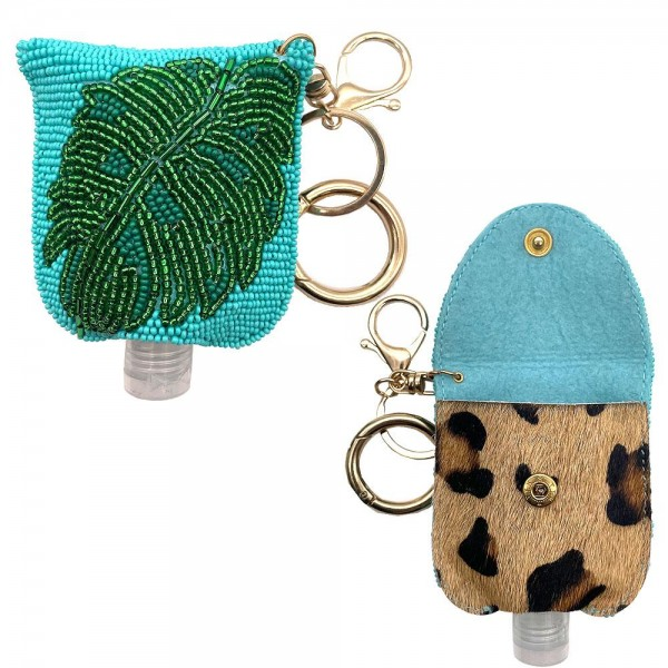 """Keep Your Self Protected While You're Out and About with This Beaded Hand Sanitizer Holder Featuring Leopard Print Accents.  - Clip to your purse, bag, or diaper bag - Keyring to hold your keys - Fits up to 1fl. oz Sanitizer Bottle - Approximately 3.5"""" T x 3"""" W  ***Hand Sanitizer NOT INCLUDED. (Comes with empty Bottle)"""