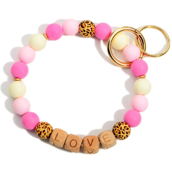 """Wooden Beaded Key Ring Featuring Block Letters that Say """"Love"""".  - Holds Keys - Can Wear on Wrist, Attach to Bags or Purses - Approximately 3.5"""" in Diameter"""