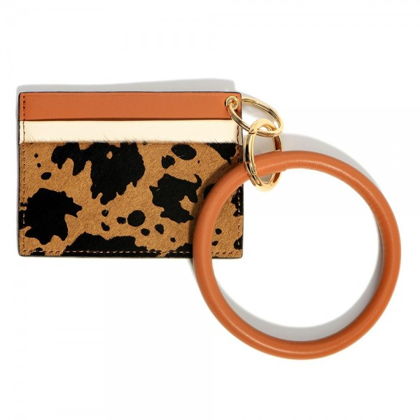 """Cow Print Wristlet Wallet Featuring Card Slots.   - Approximately 4"""" W x 3"""" L"""