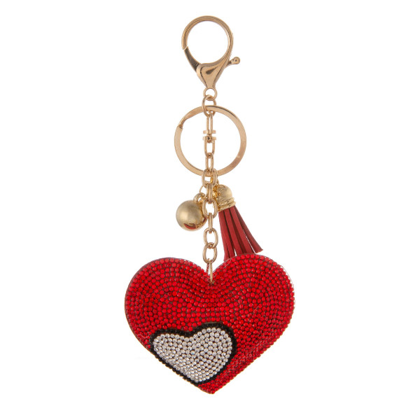 "Keychain with faux suede tassel and rhinestone heart. Approximately 2.5"" in diameter."