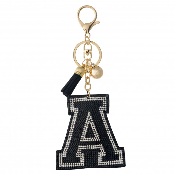 """Black initial pillow keychain/bag charm featuring rhinestone details and a tassel accent. Initial approximately 2.5"""". Approximately 6"""" in length overall."""