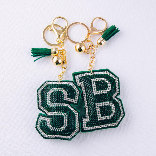 """Green initial pillow keychain/bag charm featuring rhinestone details and a tassel accent. Initial approximately 2.5"""". Approximately 6"""" in length overall."""