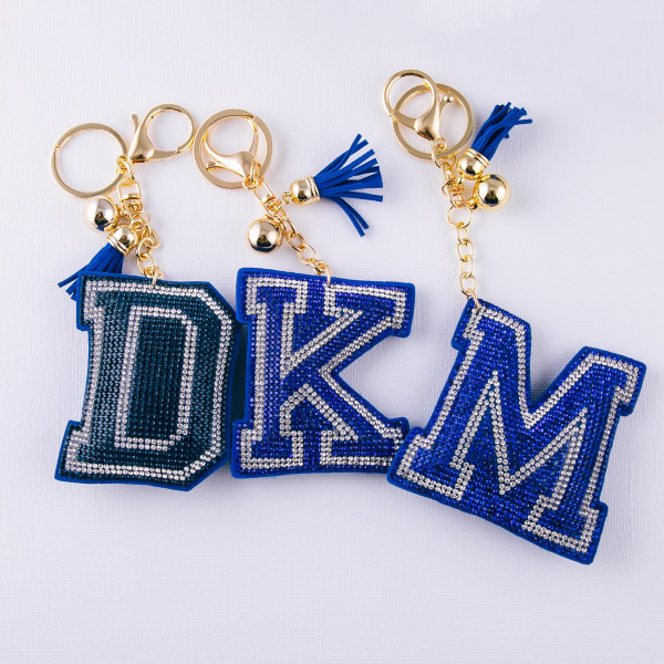 """Blue initial pillow keychain/bag charm featuring rhinestone details and a tassel accent. Initial approximately 2.5"""". Approximately 6"""" in length overall."""