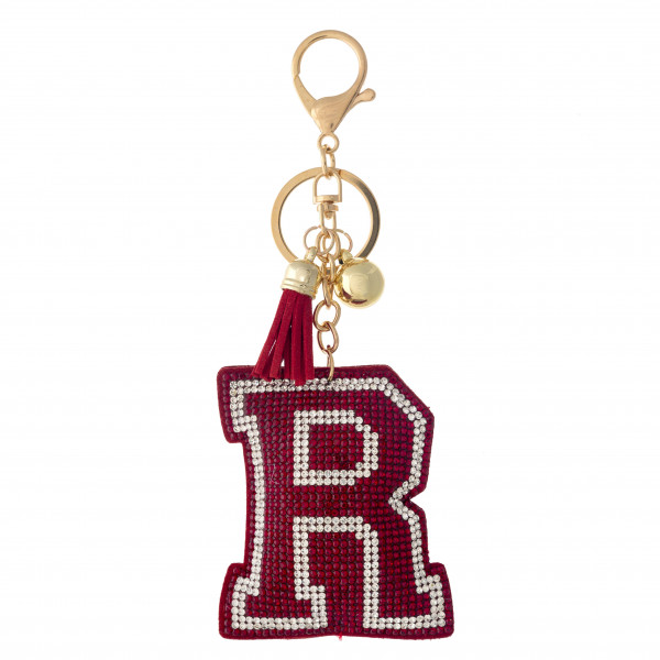"""Red initial pillow keychain/bag charm featuring rhinestone details and a tassel accent. Initial approximately 2.5"""". Approximately 6"""" in length overall."""