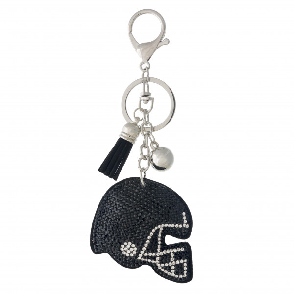 "Football helmet pillow keychain/bag charm featuring rhinestone details and a tassel accent. Helmet approximately 2"". Approximately 5"" in length overall."