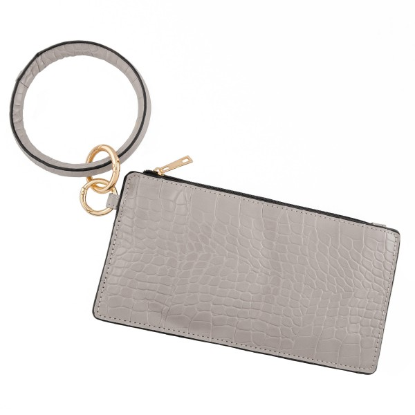 "Faux Leather Animal Print Key Ring Wallet Wristlet.  - Zipper Closure - Open Lined Inside - No Pockets - Detachable - Ring 4"" in diameter - Wallet approximately 8"" L x 4"" T - 100% PU"