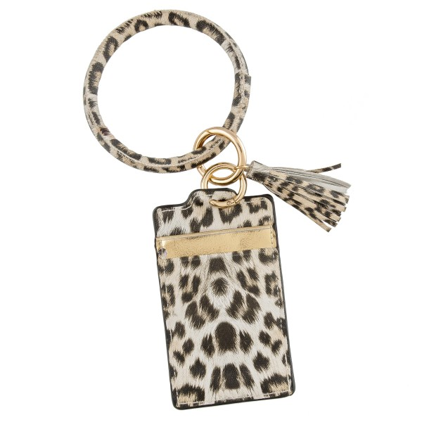 "Slim minimalist faux leather leopard print tassel card keyring holder.  - 2 functional pockets - Approximately 3"" W x 4.5"" T - Ring 3.5"" in diameter - 100% PU"