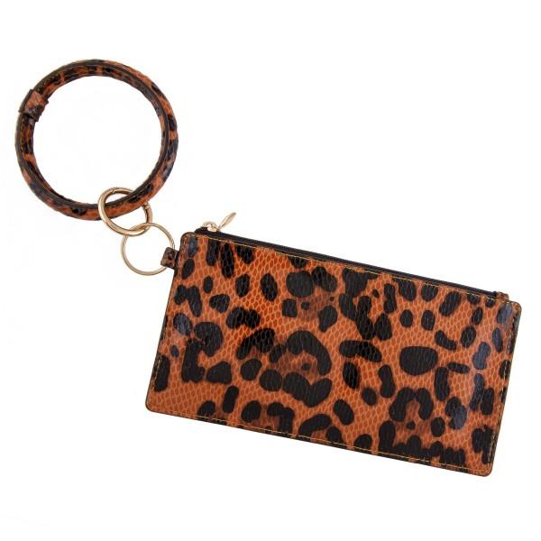 "Faux leather leopard print keyring wallet wristlet.  - Open lined inside - No pockets - Zipper closure - Detachable - Ring 4"" in diameter - Wallet approximately 8"" L x 4"" T - 100% PU"