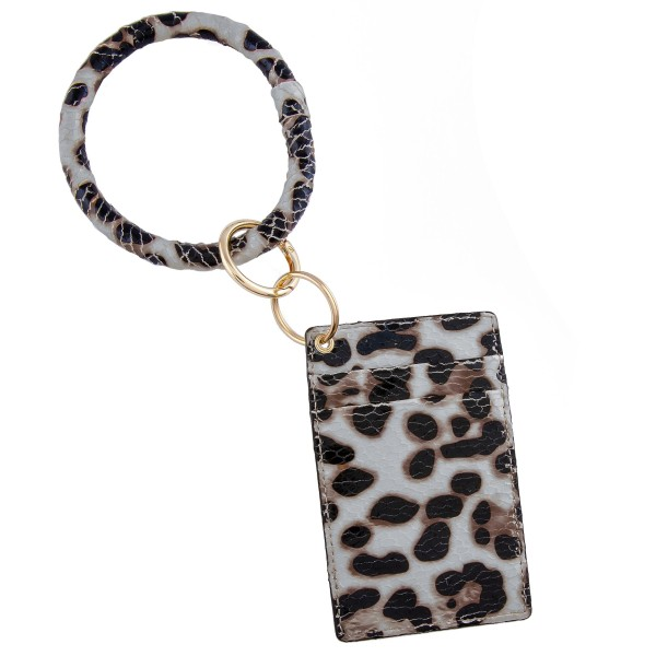 "Slim minimalist faux leather leopard print card keyring holder.  - 4 functional pockets - Approximately 3"" W x 4.5"" T - Ring 3.5"" in diameter - 100% PU"