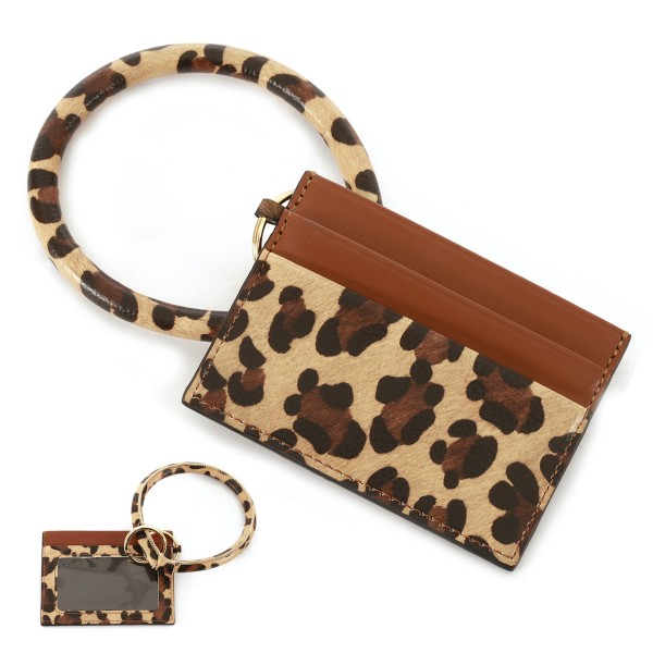 """Faux Leather Leopard Print ID/Card Holder Bangle Wristlet.  - Clear Pocket - 2 Card Pocket Holder - Detachable Key Ring  - Ring 3"""" in Diameter - Approximately 4"""" x 3"""""""