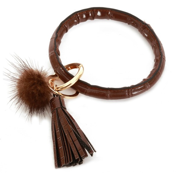 "Faux Leather Pom Tassel Key Ring.  - Hold Keys while wearing on wrist or bag - Approximately 4"" in diameter"