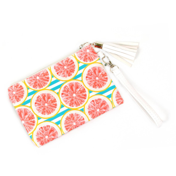"Grapefruit Print Wristlet Tassel Pouch.  - Zipper Closure - Detachable Wristlet - Interior Material: Polyester - Outside Material: PU - Approximately 7"" W x 5"" T"
