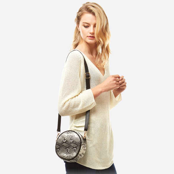 """Round Faux Leather Snakeskin Crossbody/Fanny Pack.  - Can Be Worn as Crossbody or Fanny Pack - Two Inside Functional Pockets - Approximately 7"""" in diameter - 100% PU"""