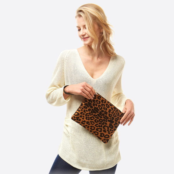 """Leopard print crossbody/clutch featuring a lined inside zipper pocket detail with gold chain link strap.  -  Approximately 11"""" W x 8.5"""" T - 100% Polyester"""