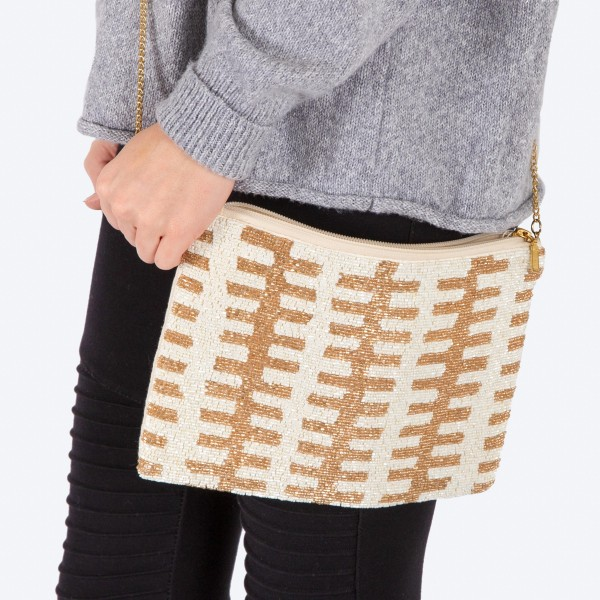 "High quality seed beaded handbag.  - Zipper closure - One inside open pocket - Inside lining 100% Cotton - Approximately 10.5"" W x 7"" T - Strap approximately 52"" L - Approximately 62"" L overall - 40% Seed beads, 40% Cotton Canvas, 20% Metal"