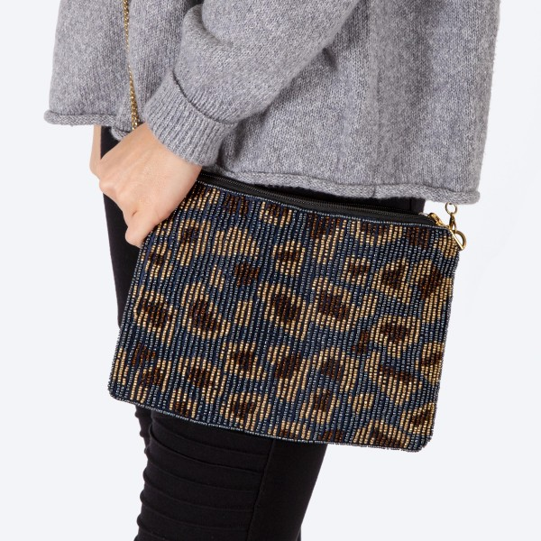 "High quality seed beaded leopard print handbag.  - Zipper closure - One inside open pocket - Inside lining 100% Cotton - Approximately 10.5"" W x 7"" T - Strap approximately 52"" L - Approximately 62"" L overall - 40% Seed beads, 40% Cotton Canvas, 20% Metal"