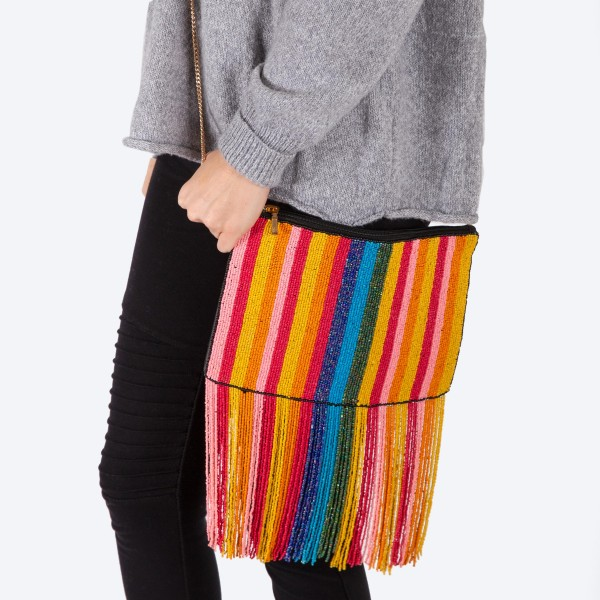 "High quality multicolor stripe seed beaded tassel handbag.  - One inside open pocket - Inside lining 100% Cotton - Approximately 10.5"" W x 7"" L - Strap approximately 52"" L - Approximately 82"" L overall - 40% Seed beads, 40% Cotton Canvas, 20% Metal"