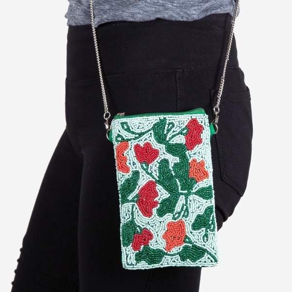 """High quality Teal flower blossom seed beaded cell phone crossbody.  - Open (100% Cotton) lined inside - No pockets - Zipper closure - Approximately 7"""" x 4""""  - Strap hangs approximately 24"""" L - 40% Seed Beads, 40% Cotton Canvas, 20% Metal"""