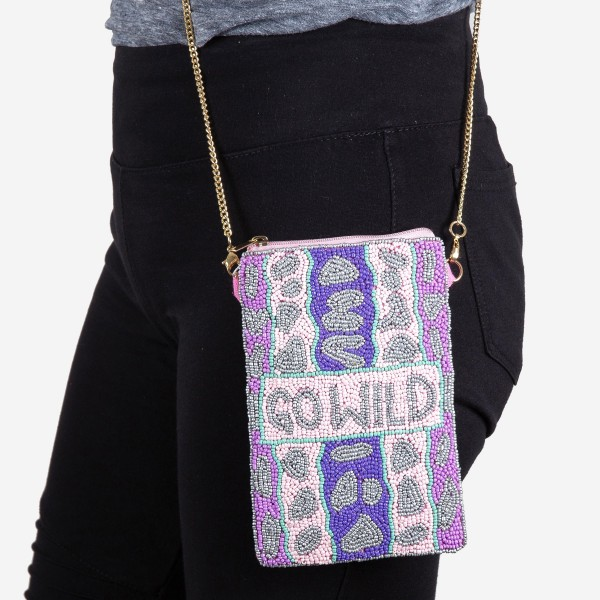"""High quality """"Go Wild"""" leopard print seed beaded cell phone crossbody.  - Open (100% Cotton) lined inside - No pockets - Zipper closure - Approximately 7"""" x 4""""  - Strap hangs approximately 24"""" L - 40% Seed Beads, 40% Cotton Canvas, 20% Metal"""