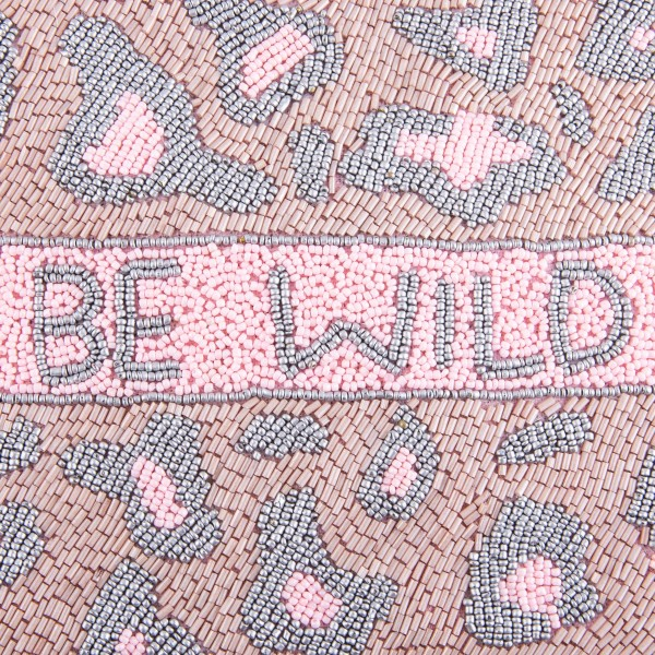 """High quality """"Be Wild"""" leopard print seed beaded crossbody clutch.  - Open (100% Cotton) lined inside - 1 inside open pocket - Zipper closure - Approximately 10"""" x 7""""  - Strap hangs approximately 26"""" L - 40% Seed Beads, 40% Cotton Canvas, 20% Metal"""