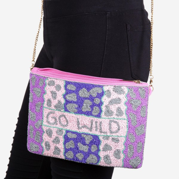 """High quality """"Go Wild"""" leopard print seed beaded crossbody clutch.  - Open (100% Cotton) lined inside - 1 inside open pocket - Zipper closure - Approximately 10"""" x 7""""  - Strap hangs approximately 26"""" L - 40% Seed Beads, 40% Cotton Canvas, 20% Metal"""