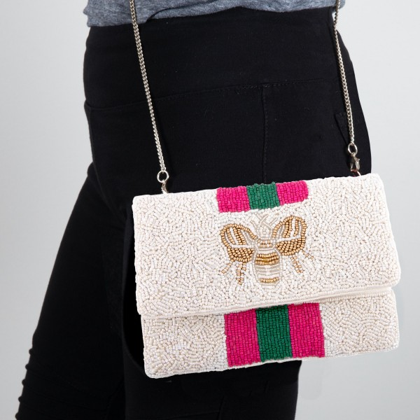 "High Quality Ivory Seed Beaded Crossbody Clutch.  - Lined inside - 1 open functional pocket - Fold over flap button closure - Approximately 7"" W x 5"" T - Strap hangs 21"" L - 100% Cotton"