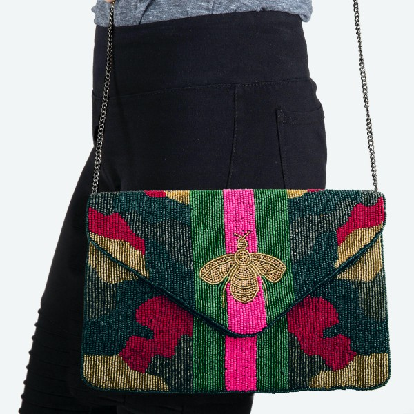 "High Quality Multicolor Seed Beaded Designer Inspired Bee Crossbody Clutch.  - Open lined inside - 1 open functional pocket - Fold over flap button closure - Approximately 10"" W x 6"" T - Strap hangs 21"" L - 100% Polyester"