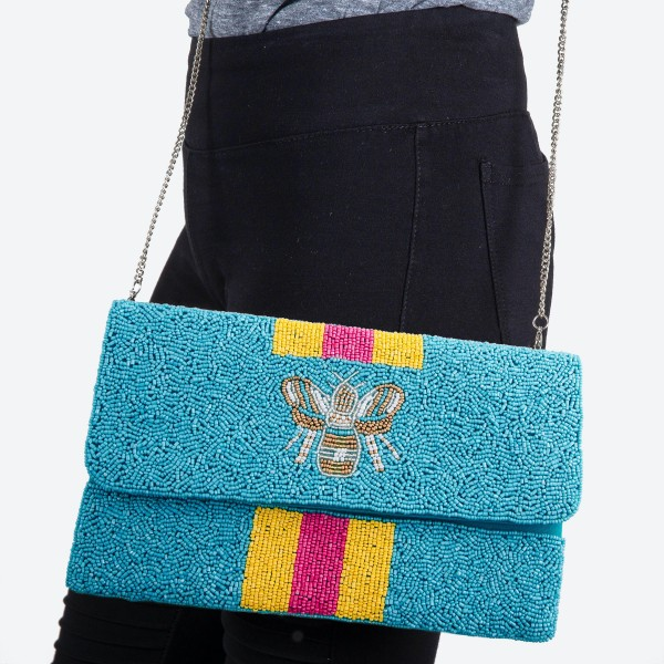 "High Quality Seed Beaded Designer Inspired Bee Crossbody Clutch.  - Open lined inside - 1 open functional pocket - Fold over flap button closure - Approximately 10"" W x 6"" T - Strap hangs 21"" L - 100% Polyester"