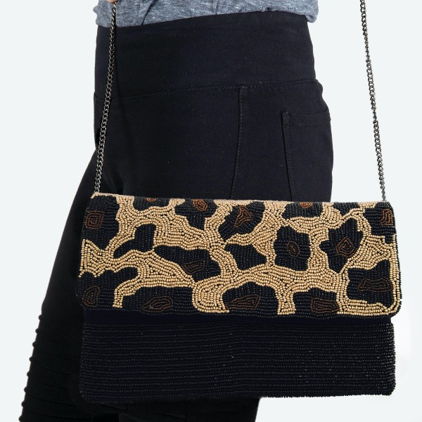 "High Quality Seed Beaded Leopard Print Crossbody Clutch.  - Open lined inside - 1 open functional pocket - Fold over flap button closure - Approximately 10"" W x 6"" T - Strap hangs 21"" L - 100% Polyester"