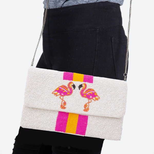 "Seed Beaded Flamingo Stripe Crossbody.  - Fold Over Snap Button Closure - One Inside Open Pocket - Lined Inside  - Metal Chain Strap - Hangs approximately 22""   - Approximately 10"" W x 6.5"" T  - 100% Cotton"
