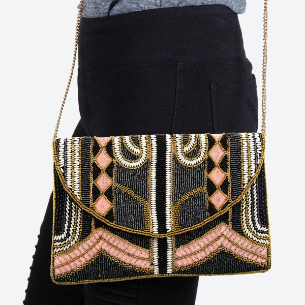 """High Quality Black Multi Seed Beaded Crossbody Clutch.  - Lined inside - 1 open functional pocket - Fold over flap button closure - Approximately 10"""" W x 6.5"""" T - Strap hangs 21"""" L - 100% Cotton"""