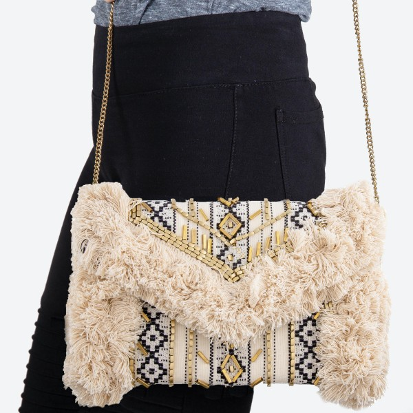"""High quality ethnic beaded shag crossbody clutch.  - Open lined inside - 1 open functional pocket - Fold over flap button closure - Approximately 12"""" W x 7"""" T - Strap hangs 21"""" L - 100% Cotton"""