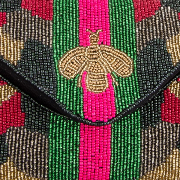 """High quality seed beaded designer inspired Bee crossbody clutch.  - Open lined inside - 1 open functional pocket - Fold over flap button closure - Approximately 7"""" W x 5"""" T - Strap hangs 22"""" L - 100% Cotton"""