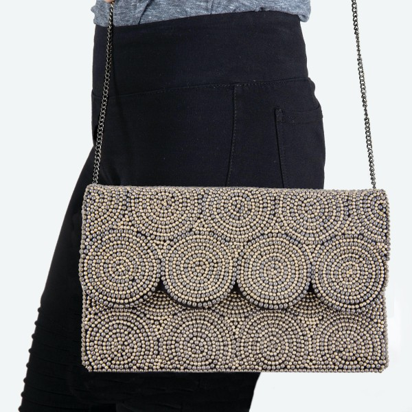 """High Quality Two Tone Ball Beaded Swirl Crossbody Clutch.  - Open lined inside - 1 open functional pocket - Fold over flap button closure - Approximately 10"""" W x 6"""" T - Strap hangs 21"""" L - 100% Cotton"""