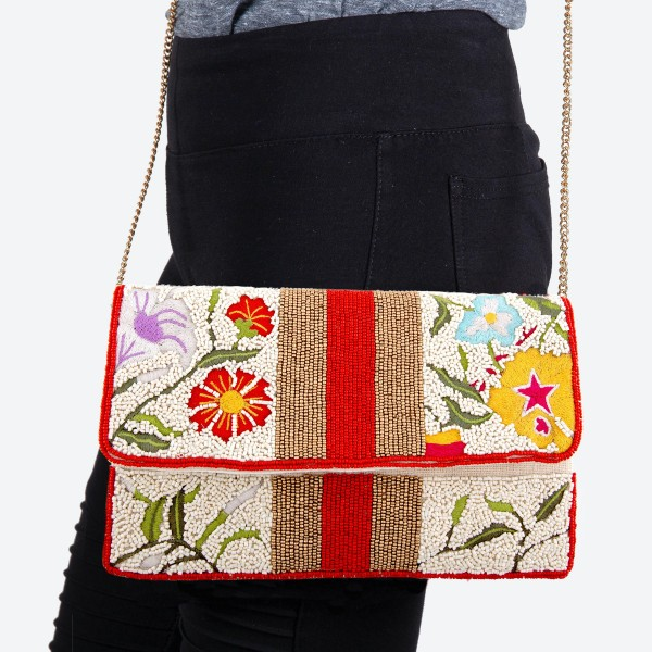"""High Quality Ivory Seed Beaded Crossbody Clutch Featuring Embroidered Floral Accents  - Lined inside - 1 open functional pocket - Fold over flap button closure - Approximately 10"""" W x 6.5"""" T - Strap hangs 21"""" L - 100% Cotton"""