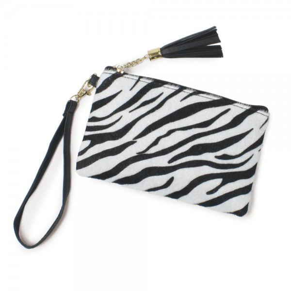 "Zebra Print Tassel Wristlet.  - Zipper Closure - Open Lined Inside  - No Pockets - Detachable Wristlet - Approximately 7"" x  5""  - 100% Polyester"