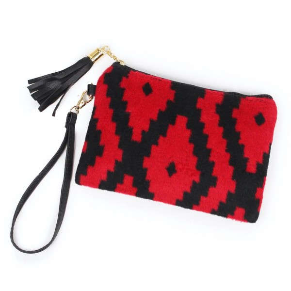 "Aztec Print Tassel Wristlet.  - Zipper Closure - Open Lined Inside  - No Pockets - Detachable Wristlet - Approximately 7"" x  5""  - 100% Polyester"