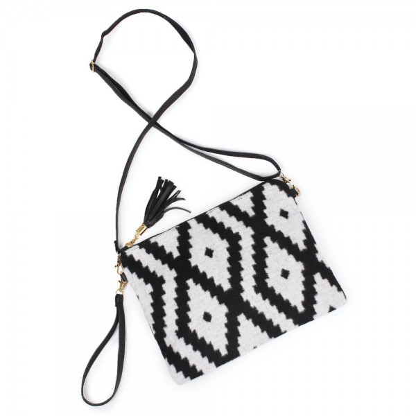 "Aztec Print Tassel Handbag.  - Zipper Closure - Open Lined Inside - 2 Functional Pockets - Detachable Faux Leather Strap - Approximately 10"" L x 8"" W"