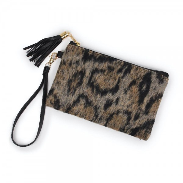 "Leopard Print Tassel Wristlet.  - Zipper Closure - Open Lined Inside  - No Pockets - Detachable Wristlet - Approximately 7"" x  5""  - 100% Polyester"