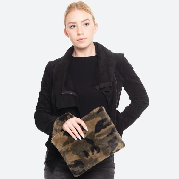 """Faux Fur Camouflage Handbag Featuring Detachable Wristlet.  - Zipper Closure - Open Lined Inside - No Pockets - Detachable 6"""" Faux Fur Wristlet - Detachable Strap - Approximately 11"""" W x 8"""" T - 100% Polyester"""