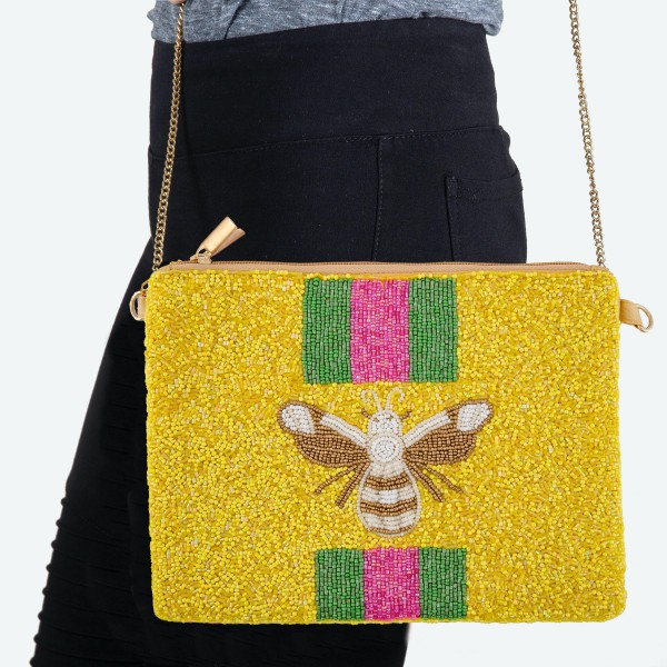 """Designer Inspired Seed Beaded Canvas Crossbody Handbag Featuring BEE Striped Detail.  - Zipper Closure  - One Inside Pocket - Spot Clean Only - Chain Link Strap 21"""" L - Approximately 9"""" W x 7"""" T - 100% Polyester"""